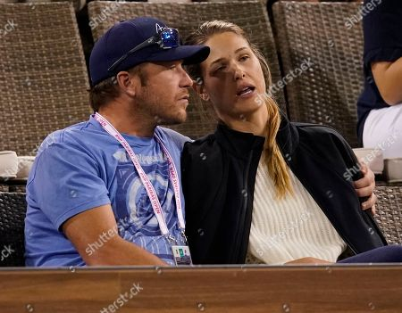 Former USA Alpine skier Bode Miller, (L) and wife, beach volleyball player and model, Morgan Miller (R) during the BNP Paribas Open at the Indian Wells Tennis Garden in Indian Wells, California, USA, 10 March 2018.
