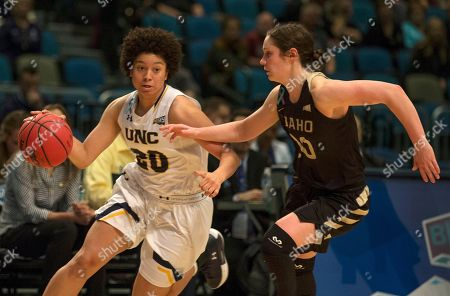 Northern Colorado's Alexis Chapman drives as Idaho's Allison Kirby defends in the second half of an NCAA college basketball game in the championship of the Big Sky Conference in Reno, Nev., Saturday, March, 10, 2018