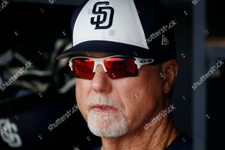 San Diego Padres bench coach Mark McGwire pauses in the dugout prior to a spring training baseball game against the Cleveland Indians, in Peoria, Ariz. The game ended in an 8-8 tie