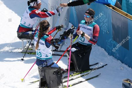 Kendall Gretsch of the United States, right and teammate Oksana Masters celebrate as they clinch gold and bronze in the Cross-Country Skiing Sitting Women's 12km event at the Alpensia Biathlon Centre during the 2018 Winter Paralympics in Pyeongchang, South Korea