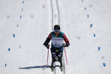 Oksana Masters of United States ski to the finish line to take bronze in the Cross-Country Skiing Sitting Women's 12km event at the Alpensia Biathlon Centre during the 2018 Winter Paralympics in Pyeongchang, South Korea