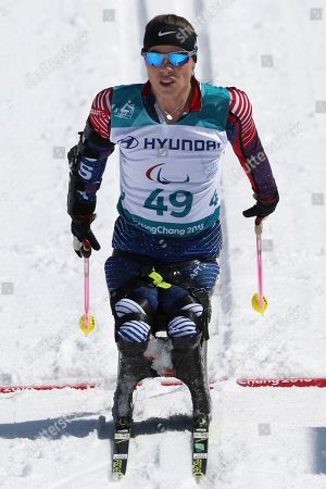 Oksana Masters of United States crosses the finish line to take bronze in the Cross-Country Skiing Sitting Women's 12km event at the Alpensia Biathlon Centre during the 2018 Winter Paralympics in Pyeongchang, South Korea