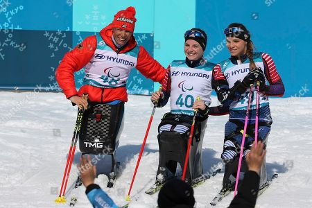 Winners of the Cross-Country Skiing Sitting Women's 12km event from left Andrea Eskau of Germany, silver; Kendall Gretsch of the United States, gold and Oksana Masters of United States, bronze at the Alpensia Biathlon Centre during the 2018 Winter Paralympics in Pyeongchang, South Korea