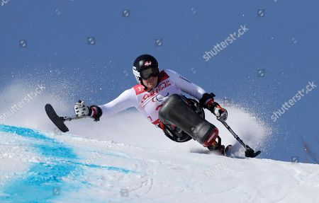 Stock Photo of Claudia Loesch of Austria competes in the women's super-G, sitting, at the 2018 Winter Paralympics in Jeongseon, South Korea