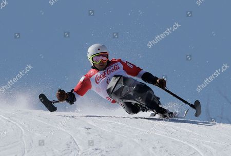 Stock Picture of Akira Kano of Japan competes in the men's super-G, sitting, at the 2018 Winter Paralympics in Jeongseon, South Korea
