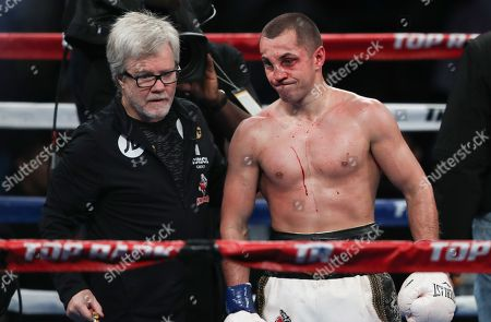 Great Britain's Scott Quigg with his trainer  Freddie Roach after he loses to  Oscar Valdez Jr  from Mexico  on points
