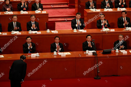 Chinese President Xi Jinping (2nd row 2-R) and Premier Li Keqiang (2nd row R) clap hands as Zhang Dejiang, chairman of the Standing Committee of the National People's Congress (NPC) bows after speaking at the third plenary session of the first session of the 13th National People's Congress at the Great Hall of the People in Beijing, China, 11 March 2018. Delegates of the NPC will vote on the amendments to the constitution on 11 March including the abolishing of the current presidential term limits. The NPC has over 3,000 delegates and is the world's largest parliament or legislative assembly though its function is largely as a formal seal of approval for the policies fixed by the leaders of the Chinese Communist Party. The NPC runs alongside the annual plenary meetings of the Chinese People's Political Consultative Conference (CPPCC), together known as 'Lianghui' or 'Two Meetings'.