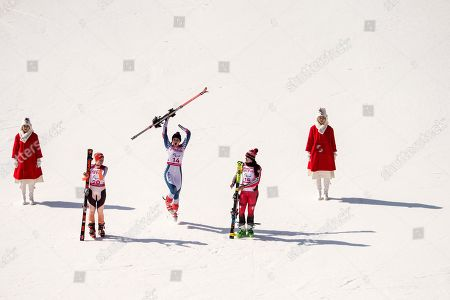 Silver medalist Andrea Rothfuss (2-L) of Germany, Gold medalist Marie Bochet (C) of France, and Bronze medalist Alana Ramsay (2-R) of Canada, celebrate on the podium after the women Alpine Skiing Super G - Standing race in the Jeongseon Alpine Centre in the Jeongseon Alpine Center during the Winter Paralympics 2018 in Pyeongchang, South Korea, 11 March 2018.