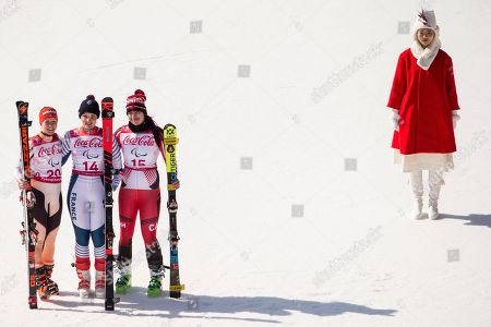 (L-R) Silver medalist Andrea Rothfuss of Germany, Gold medalist Marie Bochet of France, and Bronze medalist Alana Ramsay of Canada, celebrate on the podium after the women Alpine Skiing Super G - Standing race in the Jeongseon Alpine Centre in the Jeongseon Alpine Center during the Winter Paralympics 2018 in Pyeongchang, South Korea, 11 March 2018.