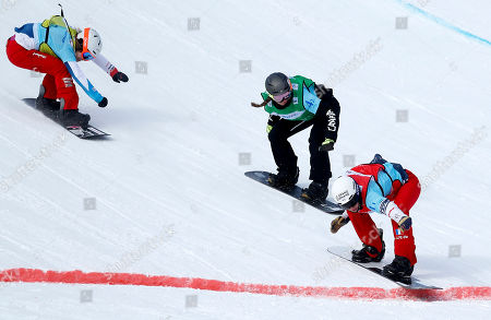 Second place winner Canada team athlete Tess Critchlow (C), first place winner team of France Nelly Moenne Loccoz (R) and third place winner Switzerland team athlete Lara Casanova (L) in action at the Big final of the Ladies Team Snowboard Cross at the FIS Snowboard World Cup 2018 in Moscow, Russia, 11 March 2018.
