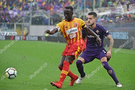 Fiorentina's Cristiano Biraghi (R) and Benevento's Bacary Sagna in action during the Italian Serie A soccer match ACF Fiorentina vs Benevento Calcio at Artemio Franchi stadium in Florence, Italy, 11 March 2018.
