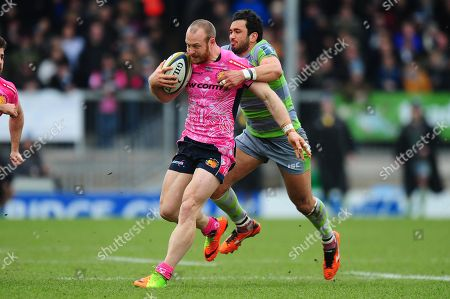 James Short of Exeter Chiefs is tackled by Maxime Mermoz of Newcastle Falcons during the Anglo-Welsh Cup semi-final match between Exeter Chiefs and Newcastle Falcons at Sandy Park on March 11th 2018, Exeter, Devon (