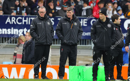 Stock Image of Exeter Chiefs Assistant Coach, Robin Hunter and Exeter Chiefs Director of Rugby, Rob Baxter look on before the Anglo-Welsh Cup semi-final match between Exeter Chiefs and Newcastle Falcons at Sandy Park on March 11th 2018, Exeter, Devon (