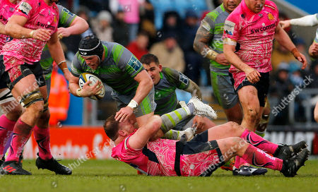 Will Welch, Captain of Newcastle Falcons is tackled by Moray Low of Exeter Chiefs during the Anglo-Welsh Cup semi-final match between Exeter Chiefs and Newcastle Falcons at Sandy Park on March 11th 2018, Exeter, Devon (