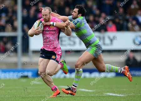 Exeter Chiefs James short is tackled by Newcastle Falcons Maxime Mermoz