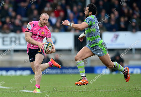 Stock Picture of Exeter Chiefs James short in action with Newcastle Falcons Maxime Mermoz