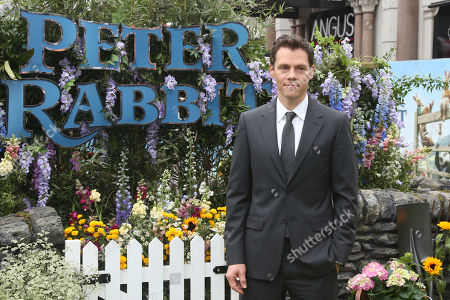 Director Will Gluck poses for photographers upon arrival at the UK Gala premiere of the film 'Peter Rabbit ' in London