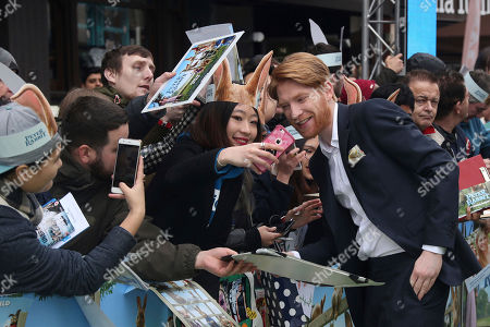 Actor Domhnall Gleeson poses for photographs upon arrival at the UK Gala premiere of the film 'Peter Rabbit ' in London