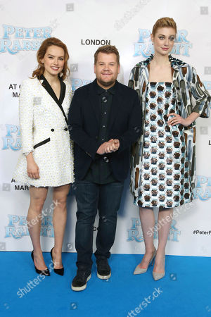 James Corden, Daisy Ridley Elizabeth Debicki. Actors James Corden, centre, Daisy Ridley, left and Elizabeth Debicki pose for photographers upon arrival at the UK Gala premiere of the film 'Peter Rabbit ' in London