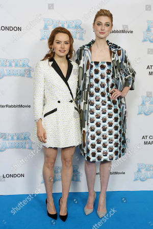 Daisy Ridley Elizabeth Debicki. Actresses Daisy Ridley, left and Elizabeth Debicki pose for photographers upon arrival at the UK Gala premiere of the film 'Peter Rabbit ' in London