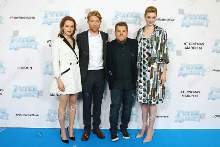 James Corden, Daisy Ridley Elizabeth Debicki, Domhnall Gleeson. Actors Daisy Ridley, from left, Domhnall Gleeson, James Corden and Elizabeth Debicki pose for photographers upon arrival at the UK Gala premiere of the film 'Peter Rabbit ' in London