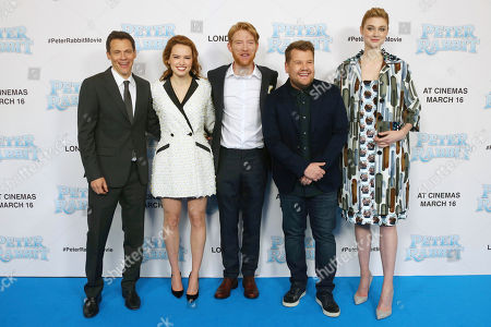 James Corden, Daisy Ridley Elizabeth Debicki, Domhnall Gleeson, Will Gluck. Director Will Gluck, from left, actors Daisy Ridley, Domhnall Gleeson, James Corden and Elizabeth Debicki pose for photographers with actors upon arrival at the UK Gala premiere of the film 'Peter Rabbit ' in London