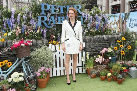 Actress Daisy Ridley poses for photographers upon arrival at the UK Gala premiere of the film 'Peter Rabbit ' in London