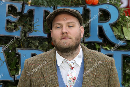 Composer Dominic Lewis poses for photographers on arrival at the premiere of the film 'Peter Rabbit', in London
