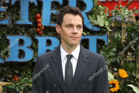 Film Director Will Gluck poses for photographers on arrival at the premiere of the film 'Peter Rabbit', in London