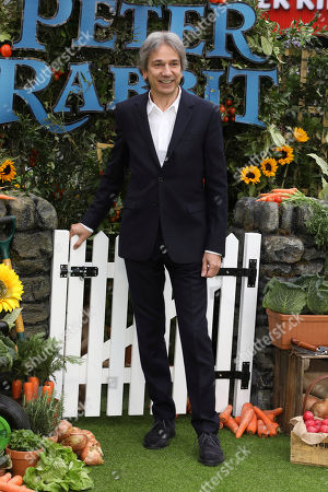 Film Producer Zareh Nalbandian poses for photographers on arrival at the premiere of the film 'Peter Rabbit', in London