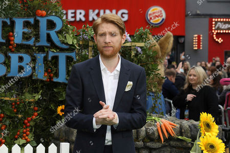 Actor Domhnall Gleeson poses for photographers on arrival at the premiere of the film 'Peter Rabbit', in London