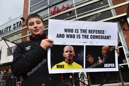"""A young fan with a poster """"Who is the Referee and Who is the Comedian"""" which is comparing Mike Dean to Jasper Carrott before the Premier League match between Bournemouth and Tottenham Hotspur at the Vitality Stadium, Bournemouth. Picture by Graham Hunt"""