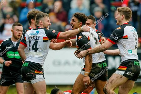 Bradford Bulls winger Dalton Grant (5) scores a try and celebrates to make the score 0-28 during the Betfred League 1 match between Keighley Cougars and Bradford Bulls at Cougar Park, Keighley. Picture by Simon Davies