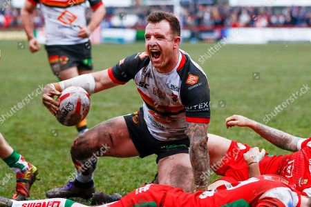 Stock Image of Bradford Bulls interchange George Flanagan (21) scores a try and celebrates during the Betfred League 1 match between Keighley Cougars and Bradford Bulls at Cougar Park, Keighley. Picture by Simon Davies