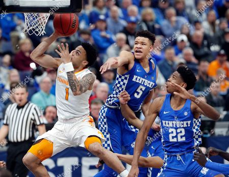 Stock Photo of Lamonte Turner, Kevin Knox, Shai Gilgeous-Alexander. Tennessee's Lamonte Turner (1) drives past Kentucky's Kevin Knox (5) and Shai Gilgeous-Alexander (22) during the second half of an NCAA college basketball championship game at the Southeastern Conference tournament, in St. Louis