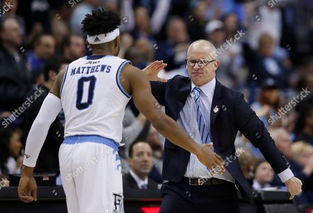 Dan Hurley, E.C. Matthews. Rhode Island head coach Dan Hurley, right, celebrates a play with guard E.C. Matthews during the first half of an NCAA college basketball championship game against Davidson in the Atlantic 10 Conference tournament, in Washington