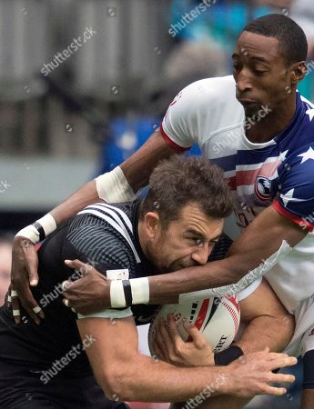 Perry Baker, right, of the United States, tackles Kurt Baker, of New Zealand, during the World Rugby Seven Series in Vancouver, British Columbia, Sunday, March, 11, 2018