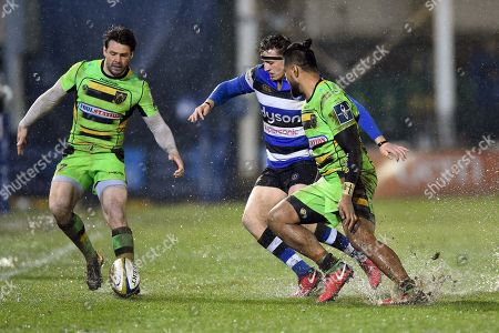 Ben Foden of Northampton Saints and Darren Atkins of Bath Rugby compete for the ball