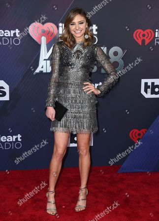Christine Evangelista arrives at the iHeartRadio Music Awards at The Forum, in Inglewood, Calif