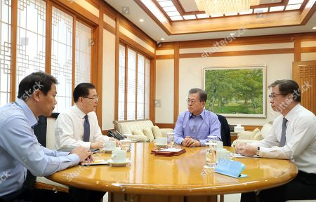 President Moon Jae-in (2-R) talks with his National Security Adviser Chung Eui-yong (2-L) and National Intelligence Service chief Suh Hoon (R) in his office Cheong Wa Dae,Seoul, South Korea  11 March 1 2018. Chung and Suh recently returned from their visit to Washington, where they explained the results of their meeting with North Korea's top leader Kim Jong-un. After the meeting, US President Donald Trump agreed to directly meet Kim as soon as possible.