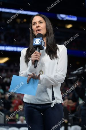 CBS Sports reporter Tracy Wolfson broadcasts from the court during the first half of an NCAA college basketball championship game between Cincinnati and Memphis at the American Athletic Conference tournament, in Orlando, Fla