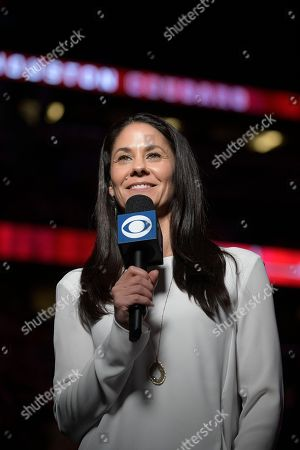 CBS Sports reporter Tracy Wolfson broadcasts from the court during the first half of an NCAA college basketball championship game between Cincinnati and Houston at the American Athletic Conference tournament, in Orlando, Fla