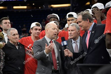 Jim Nantz, Mick Cronin, Michael Aresco. CBS Sports broadcaster Jim Nantz, right, interviews Cincinnati head coach Mick Cronin as AAC commissioner Michael Aresco, second from right, watches during the trophy presentation after an NCAA college basketball championship game against Houston at the American Athletic Conference tournament, in Orlando, Fla. Cincinnati won 56-55