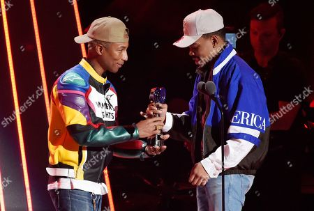 Pharrell Williams, Chance The Rapper. Pharrell Williams, left, presents Chance The Rapper with the Innovator award during the 2018 iHeartRadio Music Awards at The Forum, in Inglewood, Calif