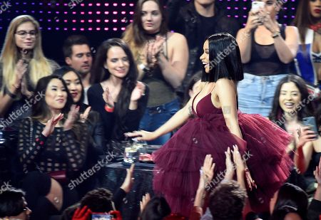Singer Cardi B makes her way through the crowd after winning Best New Artist during the 2018 iHeartRadio Music Awards at The Forum, in Inglewood, Calif