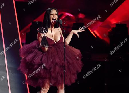 Singer Cardi B accepts the Best New Artist award during the 2018 iHeartRadio Music Awards at The Forum, in Inglewood, Calif