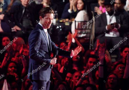 U.S. Olympic snowboarder Shaun White waves to the crowd as he introduces a performance by Bon Jovi during the 2018 iHeartRadio Music Awards at The Forum, in Inglewood, Calif