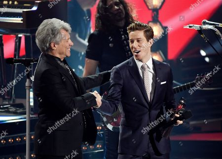 Jon Bon Jovi, Shaun White. Singer Jon Bon Jovi, left, is given the Icon Award by presenter and U.S. Olympic snowboarder Shaun White during the 2018 iHeartRadio Music Awards at The Forum, in Inglewood, Calif