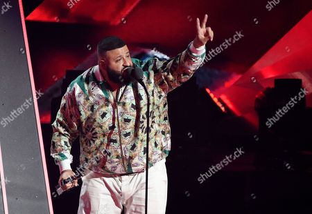 "DJ Khaled accepts the Hip-Hop Song of the Year award for ""Wild Thoughts"" during the 2018 iHeartRadio Music Awards at The Forum, in Inglewood, Calif"