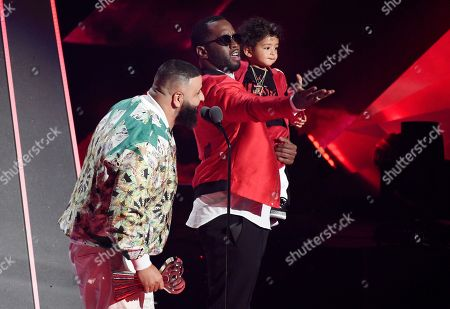 "DJ Khaled, Sean ""Diddy"" Combs. DJ Khaled, left, accepts the Hip-Hop Song of the Year for ""Wild Thoughts"" as presenter Sean ""Diddy"" Combs holds Khaled's son Asahd during the 2018 iHeartRadio Music Awards at The Forum, in Inglewood, Calif"